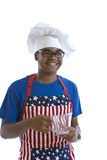 African American man in chef's hat and apron Stock Photo