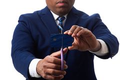 African American Man Cutting Credit Card stock images