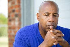 African American man in deep thought. Portrait of an African American man in deep thought Royalty Free Stock Images