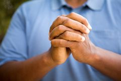 Man in deep thought in prayer and worship. Stock Photo
