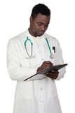 African american man doctor writing Stock Images