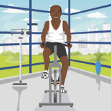 African american man doing exercise on bike at gym Stock Images