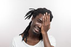 African American man with dreadlocks making facepalm gesture stock images
