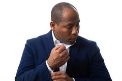 African American Man Dressed Business Casual Fixing his Shirt royalty free stock photo