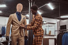 Free African-American Man Dressed In Trendy Elegant Suit, Working At Classic Menswear Store. Royalty Free Stock Photo - 129679705