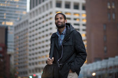 African American man en route to work in the city Stock Image