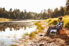 African American Man Fishing By Lake Royalty Free Stock Photo