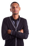 African american man with folded arms. Portrait of a young african american man with folded arms, isolated on white background Stock Photos
