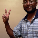 African american man gesturing a peace sign. With his hands stock photography