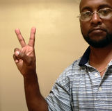 African american man gesturing a peace sign2. African american man gesturing a peace sign with his hands royalty free stock photo