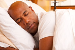 African American man getting a good nights rest. Mature African American man getting a good nights rest Stock Photography