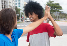 African american man give high five to a caucasian friend Stock Photos