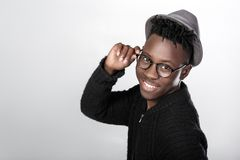 African-American man in glasses. Portrait of happy African-American man in glasses and hat Stock Photo