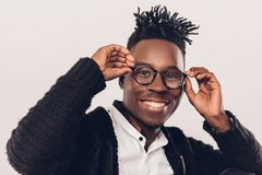 African-American man in glasses. Portrait of smiling African-American man in glasses on a gray background Royalty Free Stock Photography