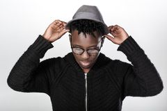 African-American man in glasses. Portrait of a young African-American man in glasses on a gray background Royalty Free Stock Photography