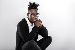 African-American man in glasses. Portrait of a young African-American man in glasses on a gray background Royalty Free Stock Photos