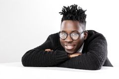 African-American man in glasses. Portrait of a young African-American man in glasses on a gray background Royalty Free Stock Photo