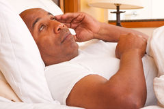 African American man having trouble sleeping. Mature African American man having trouble sleeping Royalty Free Stock Image