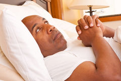 African American man having trouble sleeping. Mature African American man having trouble sleeping Royalty Free Stock Photo