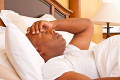 African American man having trouble sleeping. Mature African American man having trouble sleeping Royalty Free Stock Photography