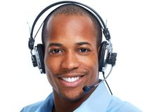 African American man in headsets. Royalty Free Stock Image