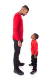 African American man with his little boy isolated on white backg Royalty Free Stock Photos