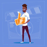 African American Man Hold Thumb Up Modern Video Blogger Vlog Creator Channel Like. Flat Vector Illustration Stock Photo