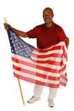 African American man holding American Flag. With pride on pure white background royalty free stock photography