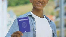African-american man holding blue passport, migration policy, visa-free regime. Stock footage stock video footage