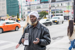 African American man holding brochure Stock Images