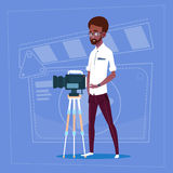 African American Man Holding Camera On Tripod Modern Video Blogger Filming Popular Vlog. Flat Vector Illustration Royalty Free Stock Photography