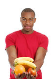 African american man holding fruits Stock Images