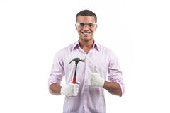 African american man holding hammer. Handsome man standing and showing thumb up Royalty Free Stock Photos