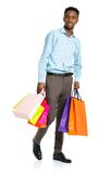 African american man holding shopping bags on white background. Stock Photo