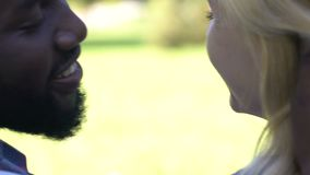 African-american man kissing on cheek and hugging his girlfriend, back view. Stock footage stock video