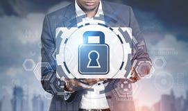 African American man laptop, digital security Royalty Free Stock Image