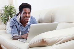 African-American man with laptop. Royalty Free Stock Photo