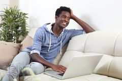 African-American man with laptop. Stock Photography