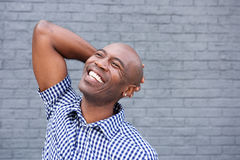 African american man laughing and looking up Stock Image