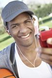 African American Man Listening To Music Stock Images