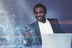 African American man looking at phone, polygons Royalty Free Stock Photo