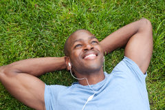 African American man lying in grass Stock Image
