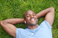 African American man lying in grass Stock Photography