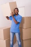 African american man moving. Young african american man moving apartment Royalty Free Stock Photography
