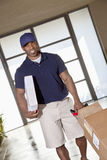 African American man with packages to deliver Stock Images