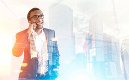 African American man on phone, foggy city Stock Photo