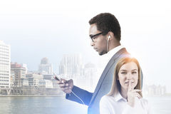 African American man with a phone, woman, city Royalty Free Stock Photography