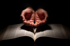 Free African American Man Praying With Hands Open On Top Of The Bible Royalty Free Stock Photography - 140307827
