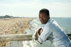 African american man relaxing at the beach on a summer day Stock Photo