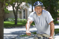 African American Man Riding Bike Stock Photography